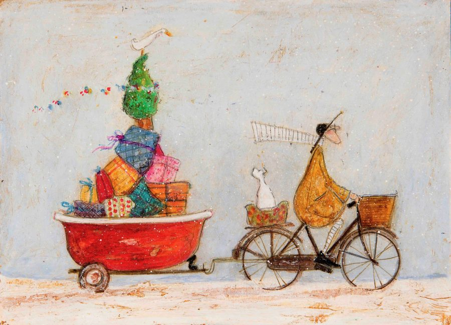 A cyclist with a stripy scarf pulling an old tin bath filled with wrapped presents
