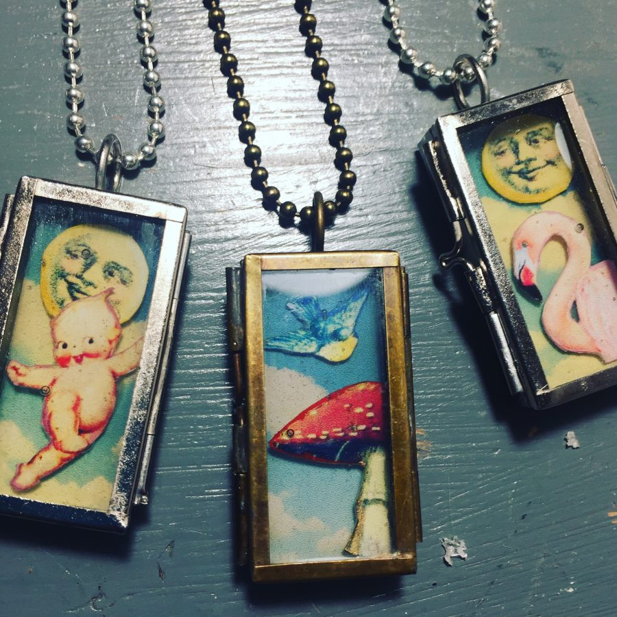 Kitsch collage displayed in a tin miniature shadow box necklace with glass front.
