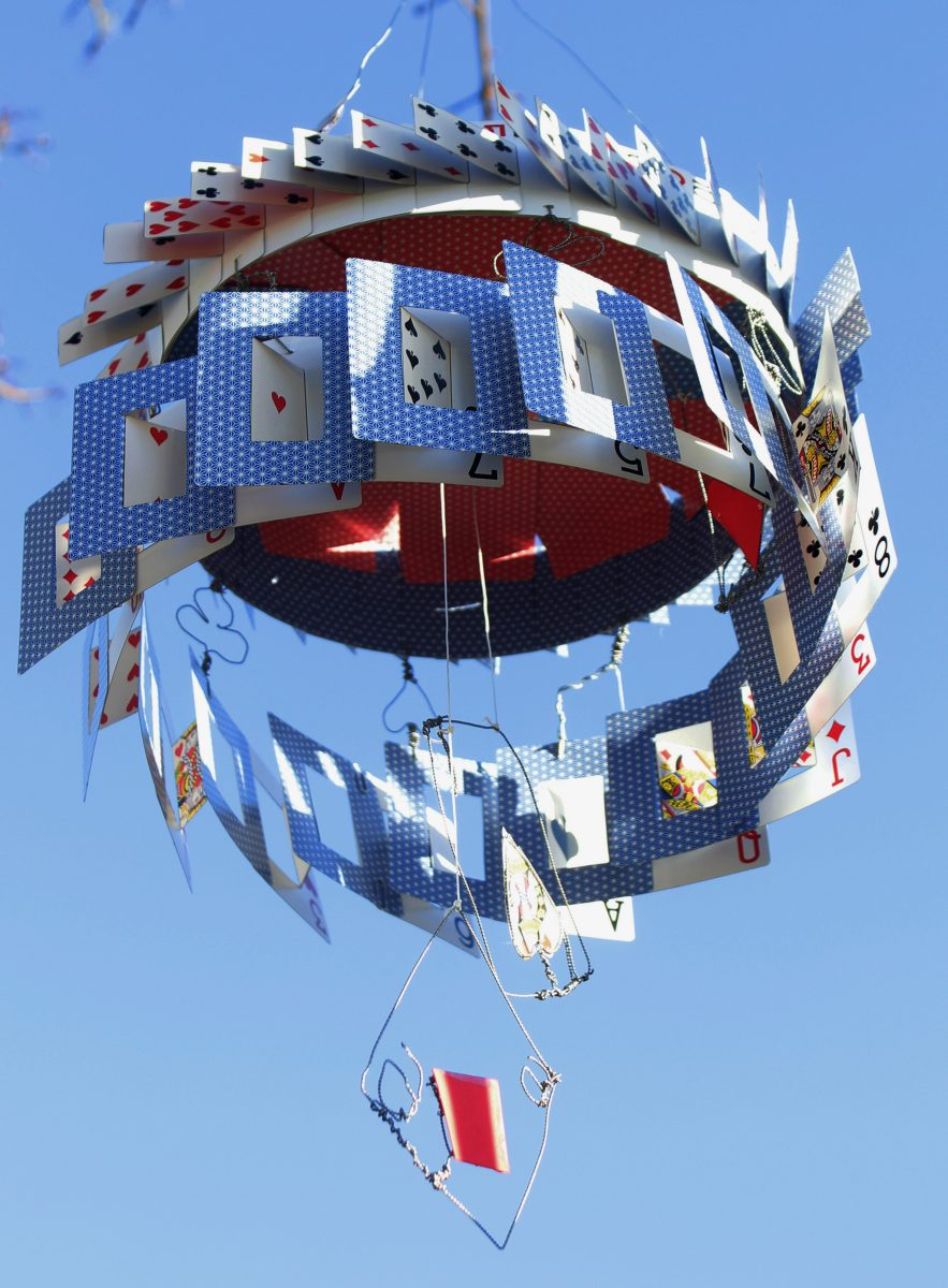 A hanging sculpture made of playing cards