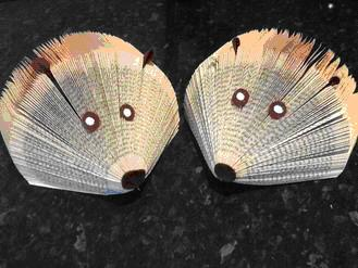 Cute Hedgehog letter holders made from old books with felt fabric features.