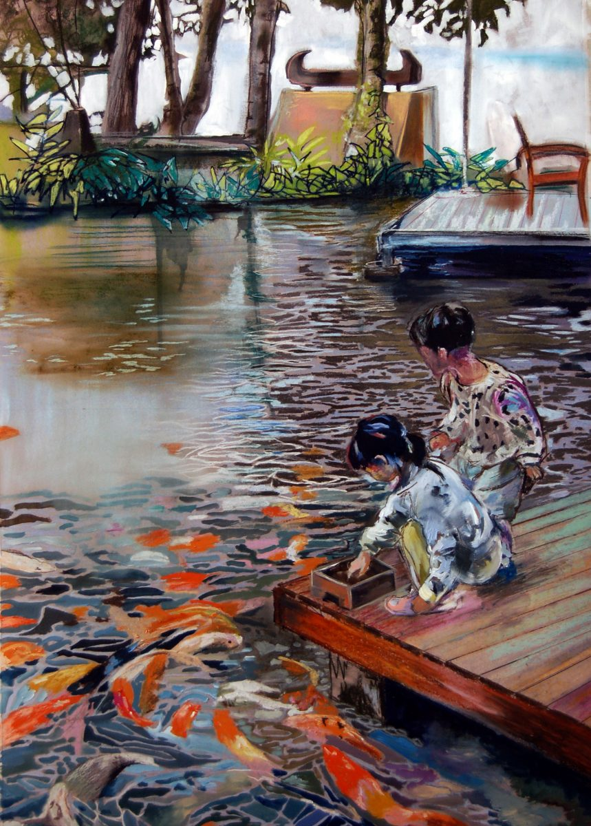Two children feeding Koi Carp in Thai waters.
