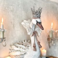 Paper mache sculpture of a crowned swan wall trophy wearing a ruff around its neck