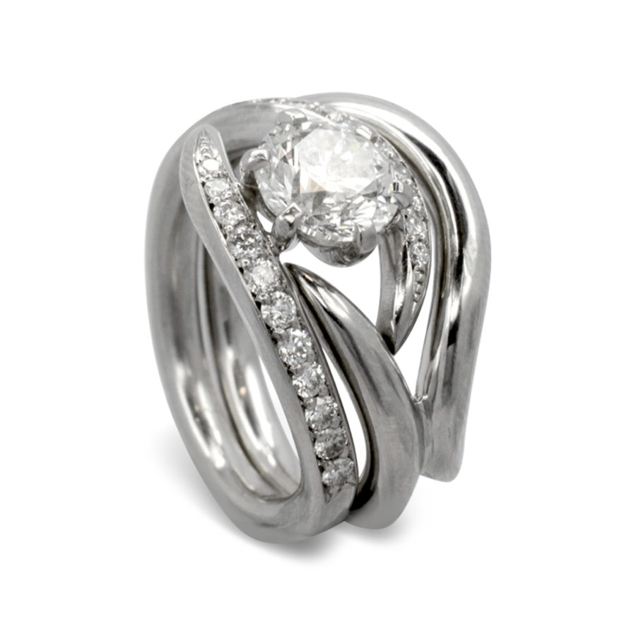 Claw set diamond spiky ring with pavé set diamond shoulders and a fitted platinum band.