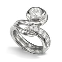 Platinum swirl ring design with a single large diamond in a rubover setting and a pavé set diamond tail