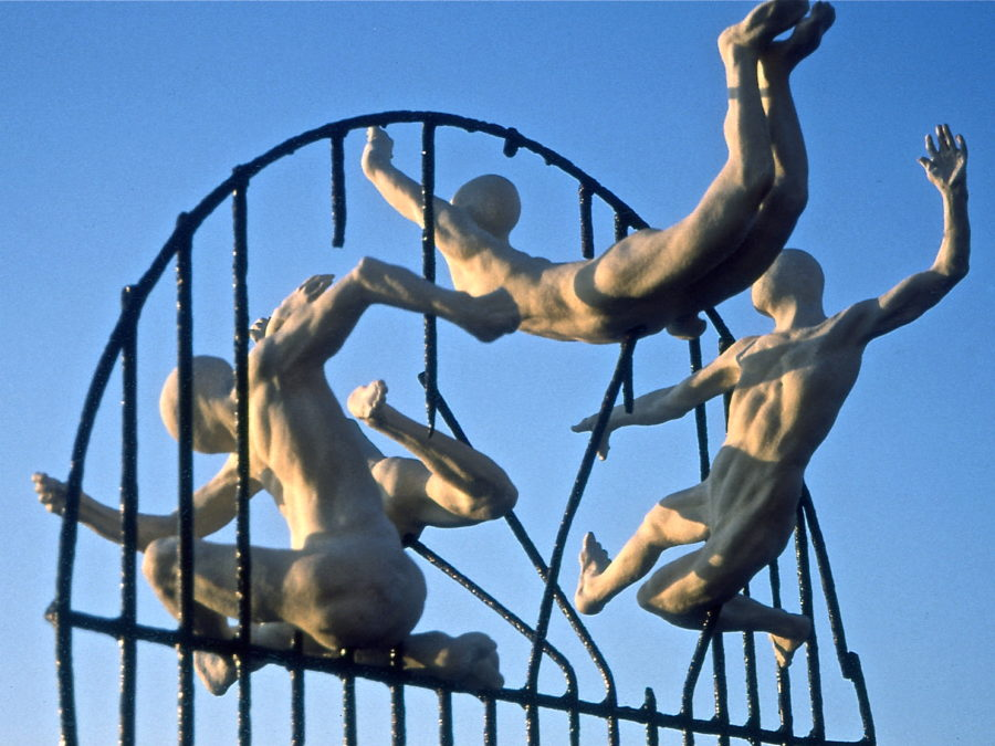 Bronze figures flying through a broken cage