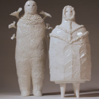 Two fine porcelain white little figures with foliage growing out of the bodies