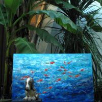 Sea painting and dog ceramic under a banana tree