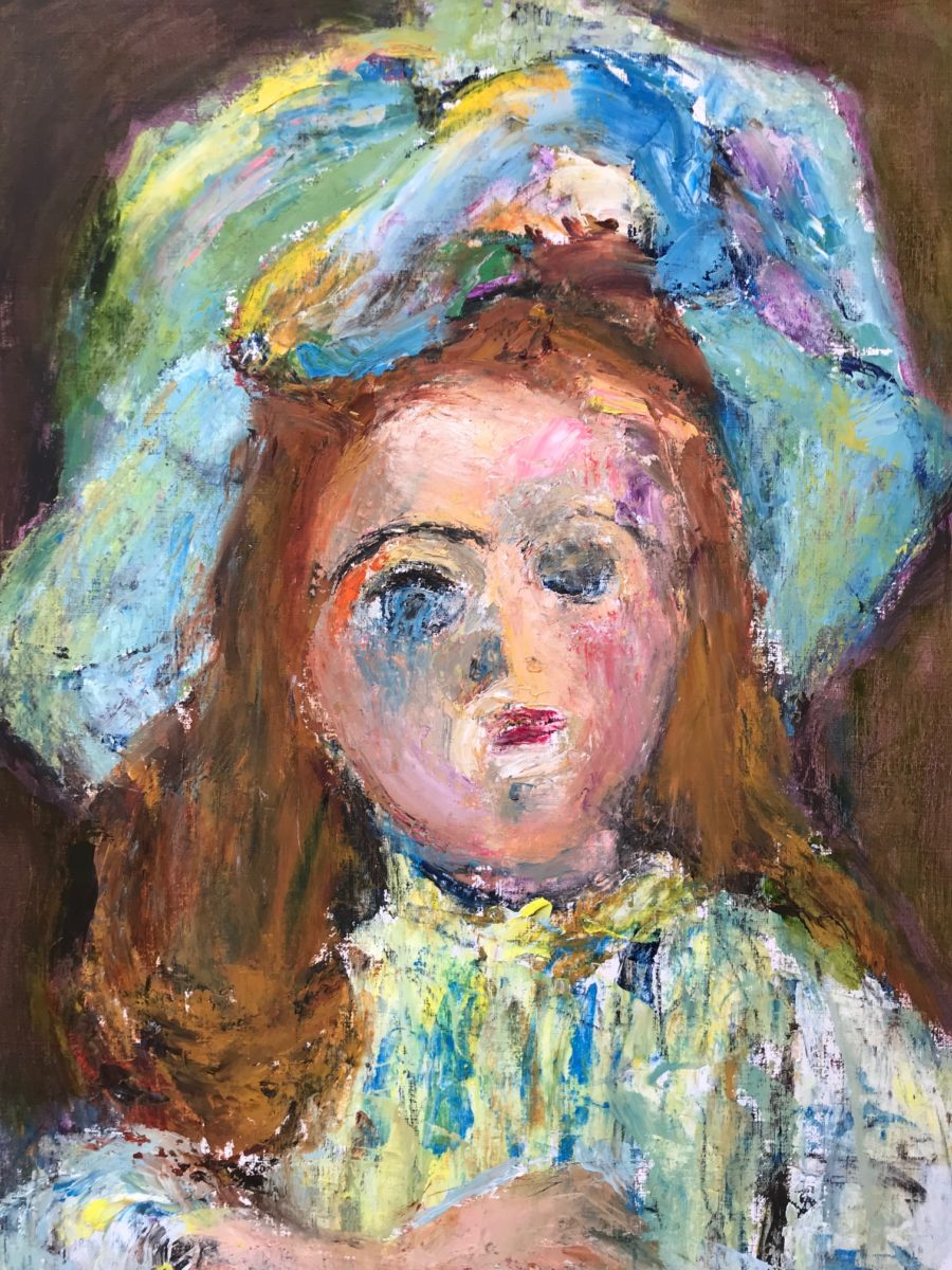 Portrait of a female doll with a green hat