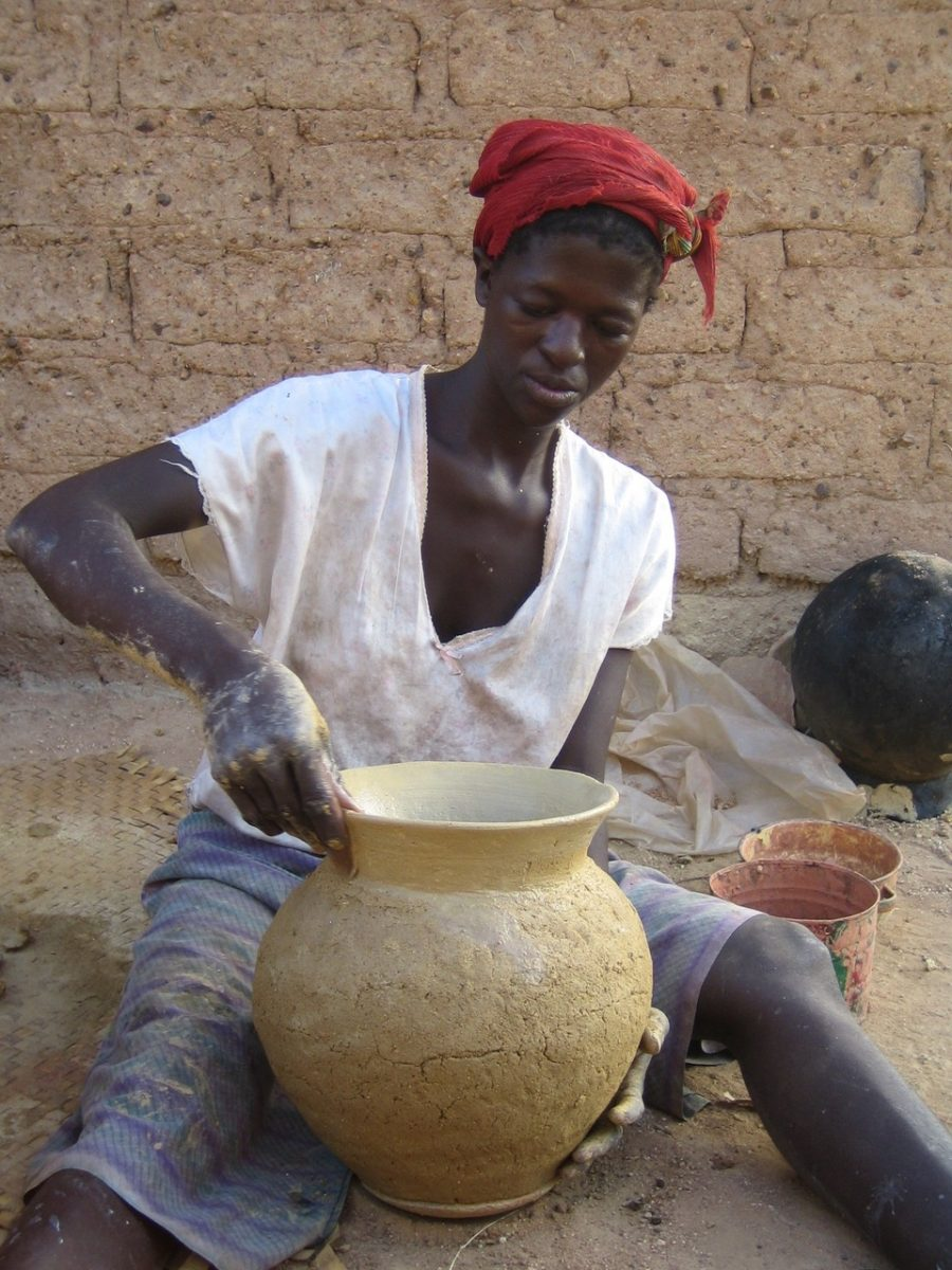Woman making water storage pot in Burkina Faso, West Africa