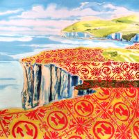 Landscape with pattern in red. The pattern is made up of the priority road sign, the landscapw is a view across the Seven Sisters. Sea, clifts and hill tops.