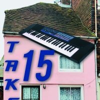 Photo of Pink Village House with Keyboard on roof