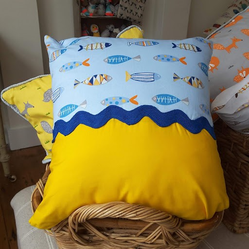 Cushion with Sandy beach, Blue wave and Fishes in the sea.