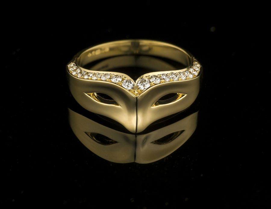 mask ring, in gold set with diamonds