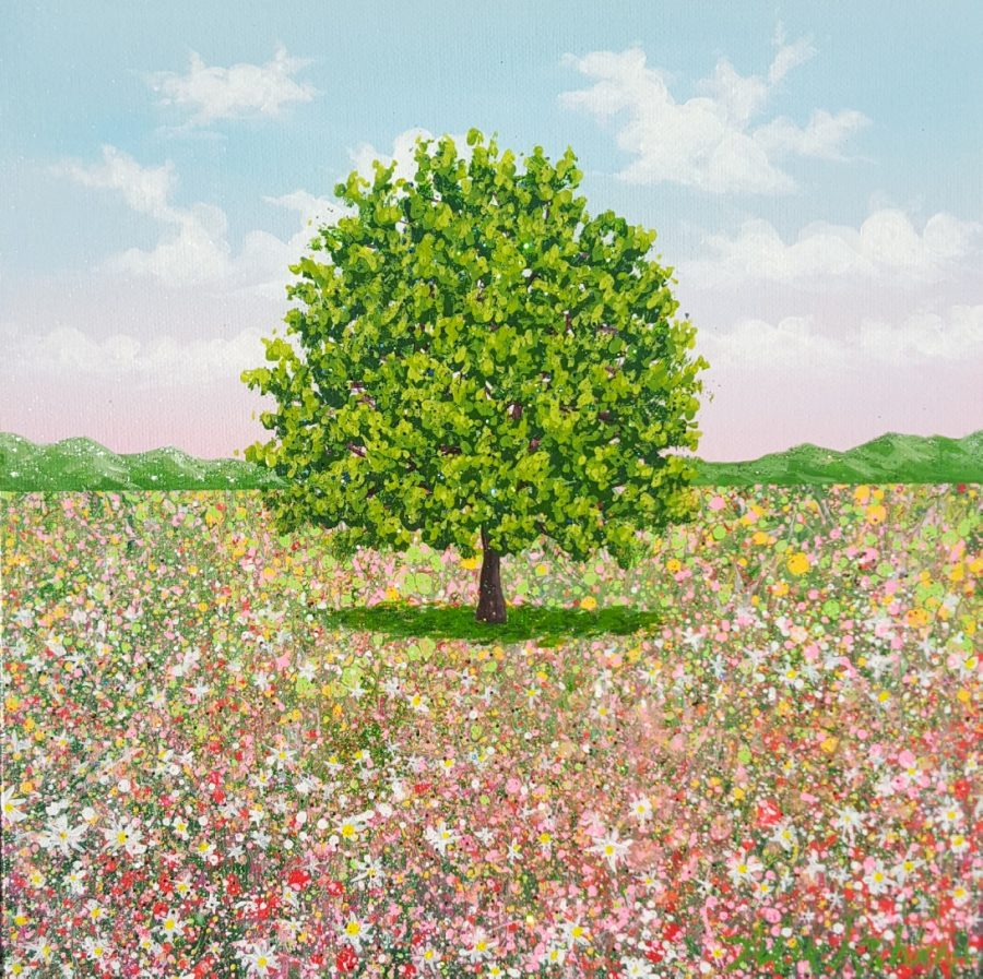 A lone tree in a beautiful floral meadow
