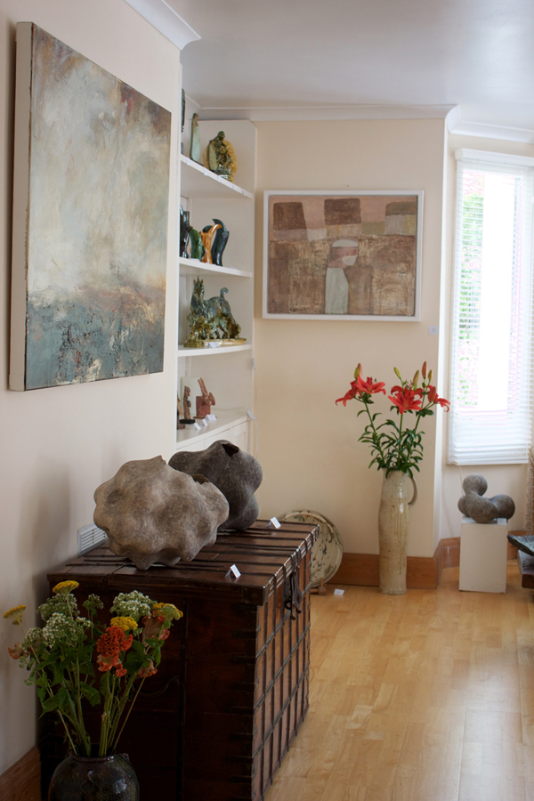 Image from a previous exhibition showing part of our living room with paintings and ceramics on display
