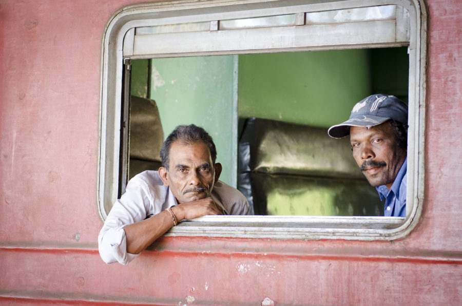 Portrait of two men on the train to Ella, Sri Lanka