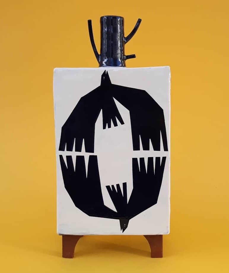 Black and white ceramic vessel with stylised birds