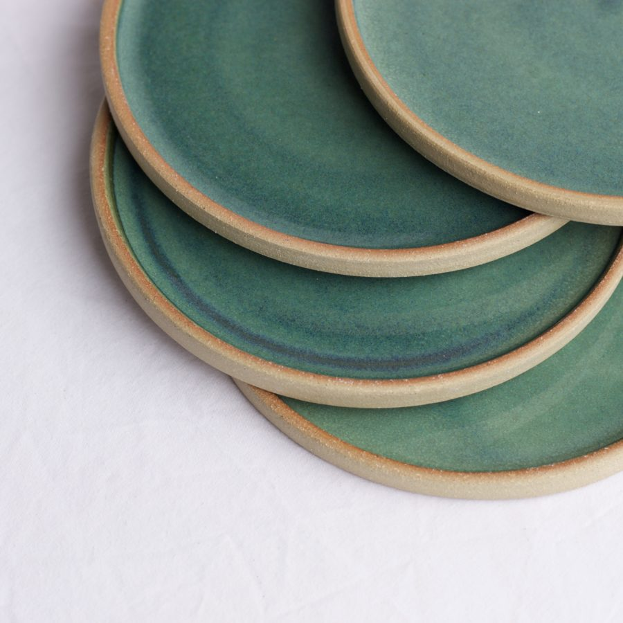 Earthenware plates with green glaze.