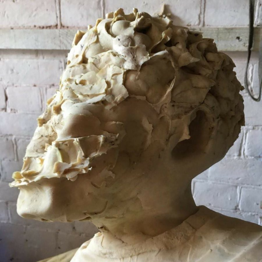 Latex rubber mould of a cast plaster head turned inside out which distorts the features of the face.