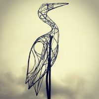 Willow lantern structure of a heron recreated in steel rod.