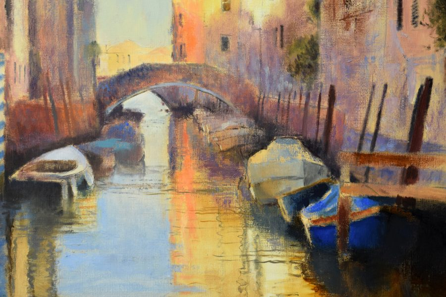 Boats floating on a silent canal as the sun rises at 7.00am
