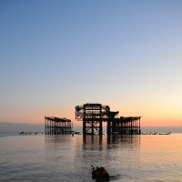 Photograph of the West Pier at sunset with a very low tide
