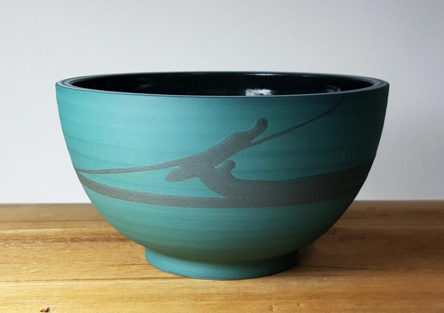 Turquoise bowl with dark swirl