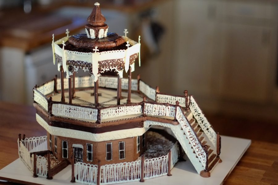 The beautiful Brighton Bandstand has been lovingly recreated using the natural colours of milk, dark and white chocolate. There is plenty of fine filigree detail piped in chocolate replicating the railings and the details of this iconic building. It is approximately the size of 50cm cube.