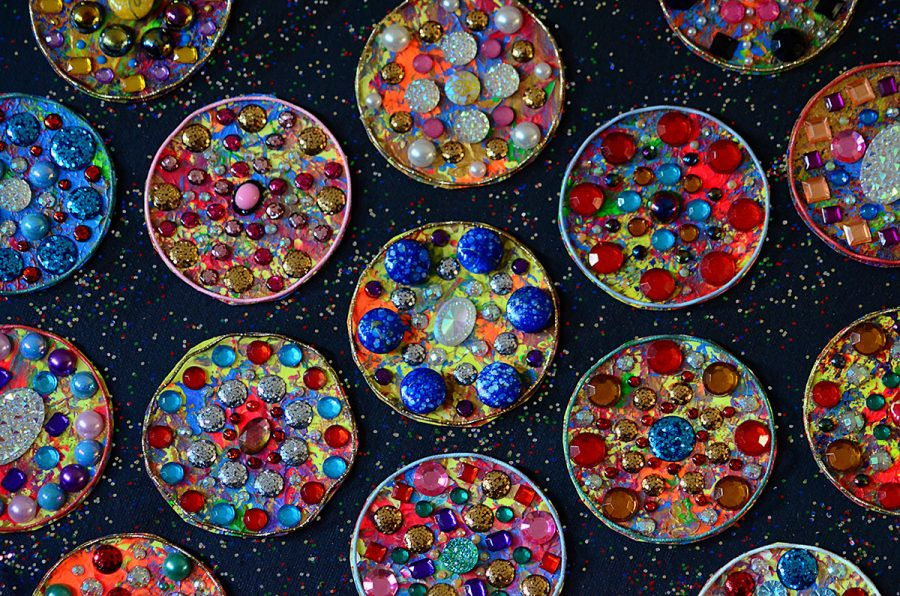 Black background with circles of jewels and colours.