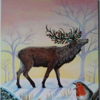 Stag in snowy forest with holly berries wrapped around his antlers.