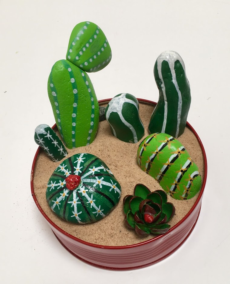Faux cacti garden painted on beach pebbles