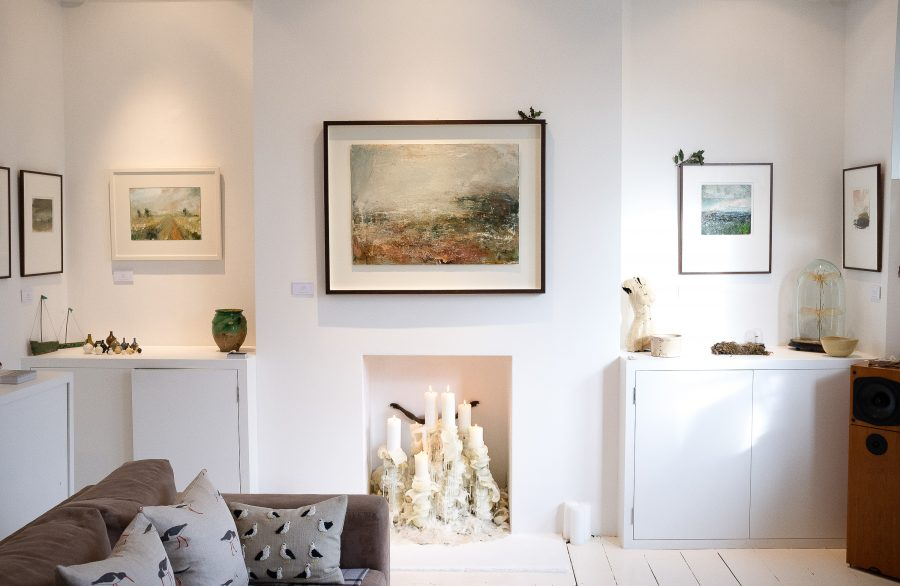 Contemporary white space in Victorian home exhibiting paintings and works on paper