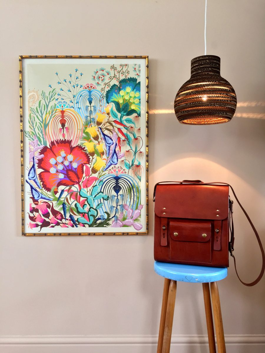 Framed floral print, handmade leather satchel on stool and handmade sustainable lampshade