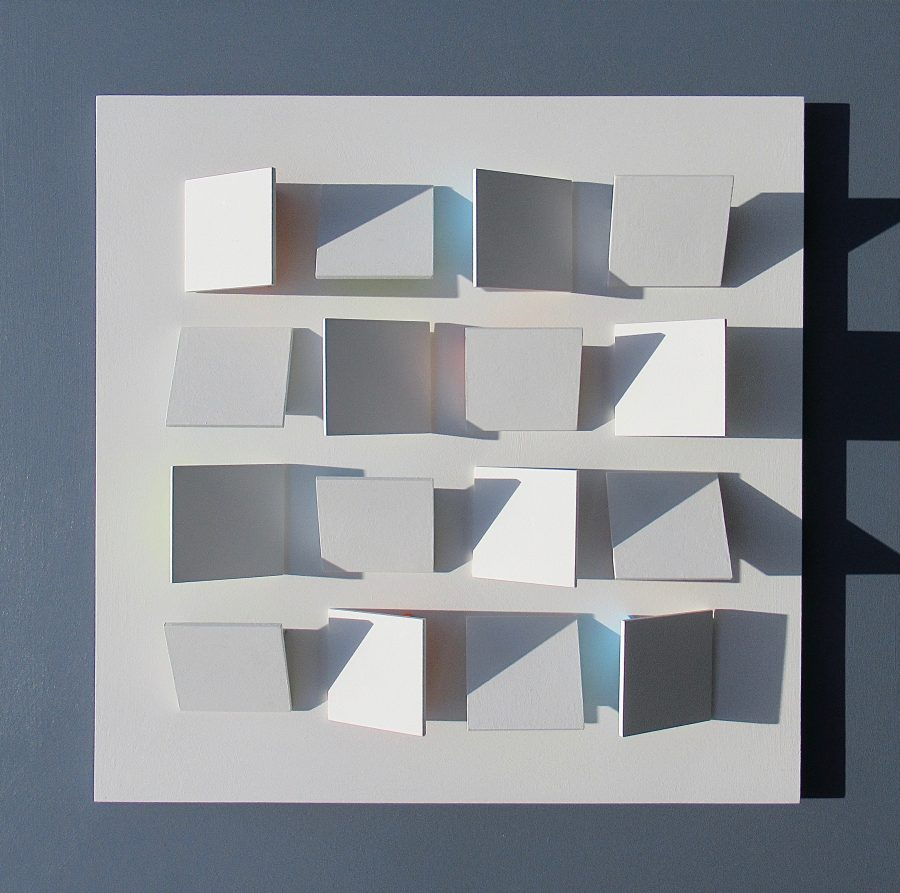 A three dimensional bas-relief construction of angled square tiles on a square background.