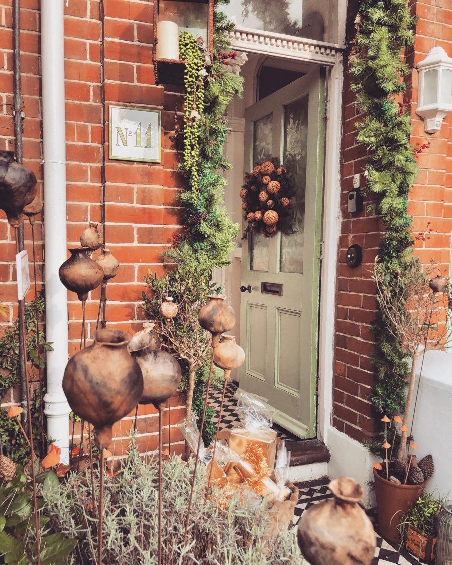Christmassy wreath doorway with ceramic sculptures