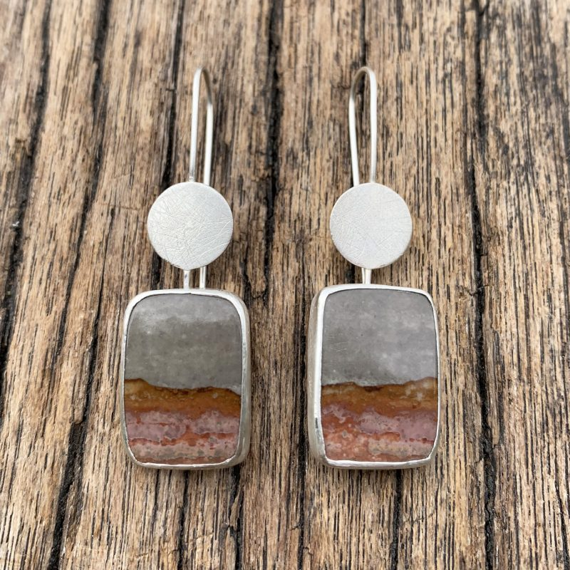 Rectangular landscape patterned Jasper gemstones suspended from fine silver wires with a textured discs.