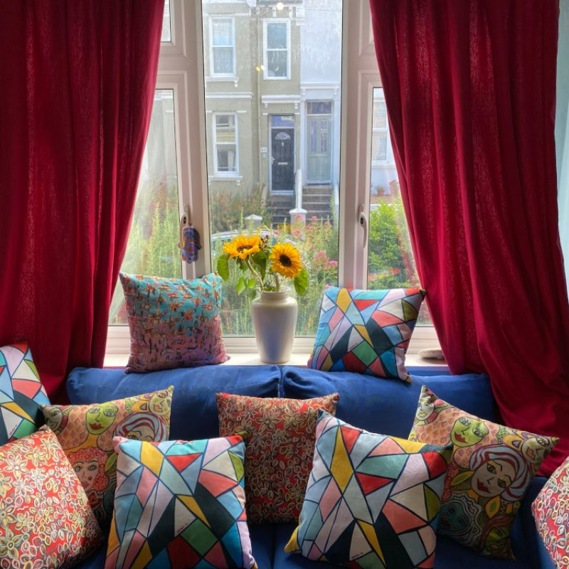 A Picture of cushions with Orna's artwork on them.