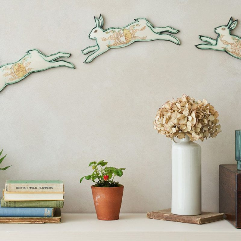 three leaping Hares