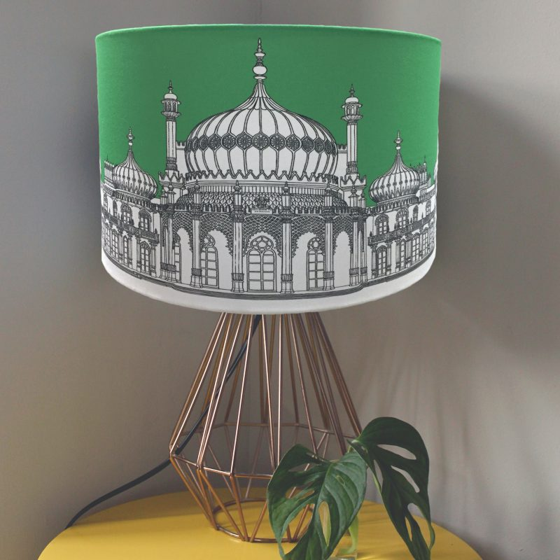 Cotton Drum Lampshade featuring a graphic image of Brighton Pavilion with a green background