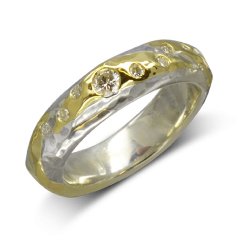A Hammered Gold Silver Diamond Ring. Set with a 3mm round and six 1.2-1.5mm diamonds.