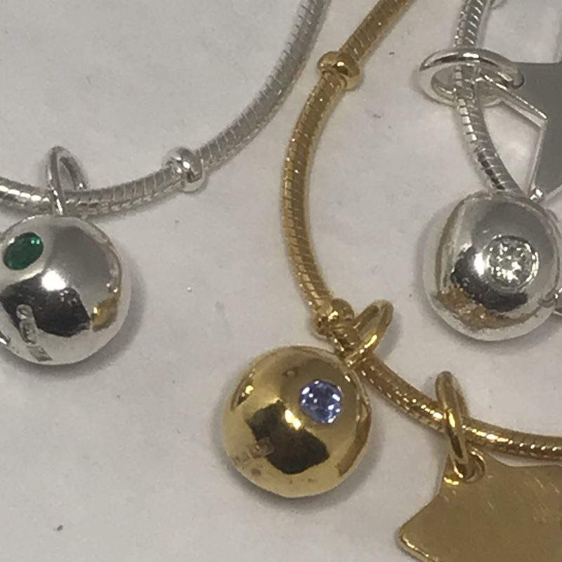Birthstone necklaces are sterling silver and gold vermeili