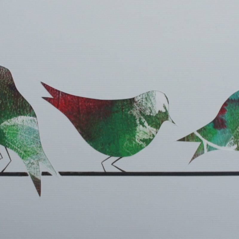A row of birds sitting on a branch