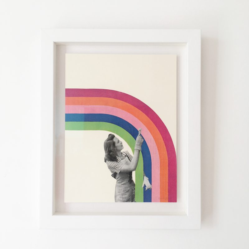 Print of a black and white image of a woman from a vintage magazine with a paintbrush next to a digital rainbow