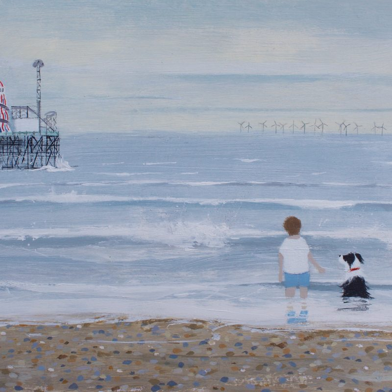 Print of an acrylic painting showing a man and dog looking out at the wind farm with the Palace Pier to the left of the picture