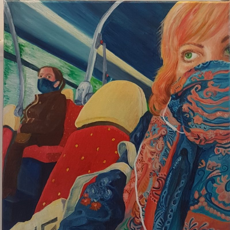 A colourful self portrait of the artist, wearing a decorative face covering on a Brighton bus.