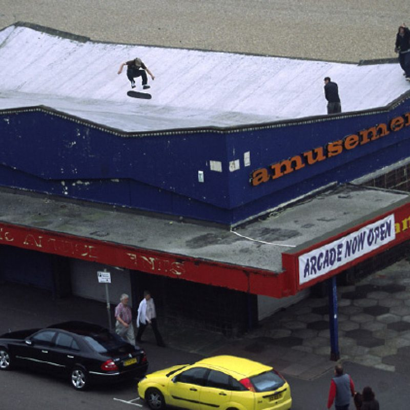 Skateboarding on a rooftop of a Brighton amusement arcade. The amusement arcade was demolished the day after this photograph was taken.