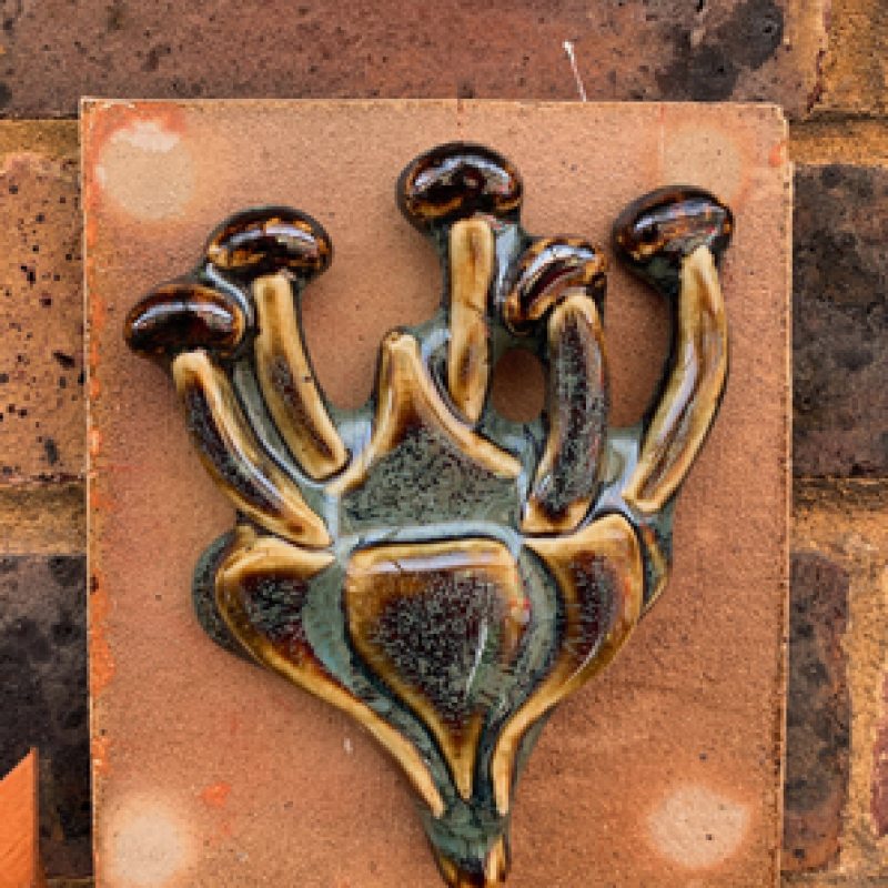 Plant form on a clay slab
