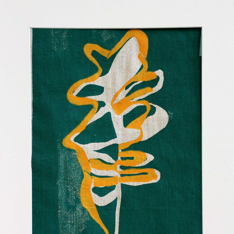 paper cut leaf design, overlaid yellow screen print on green background