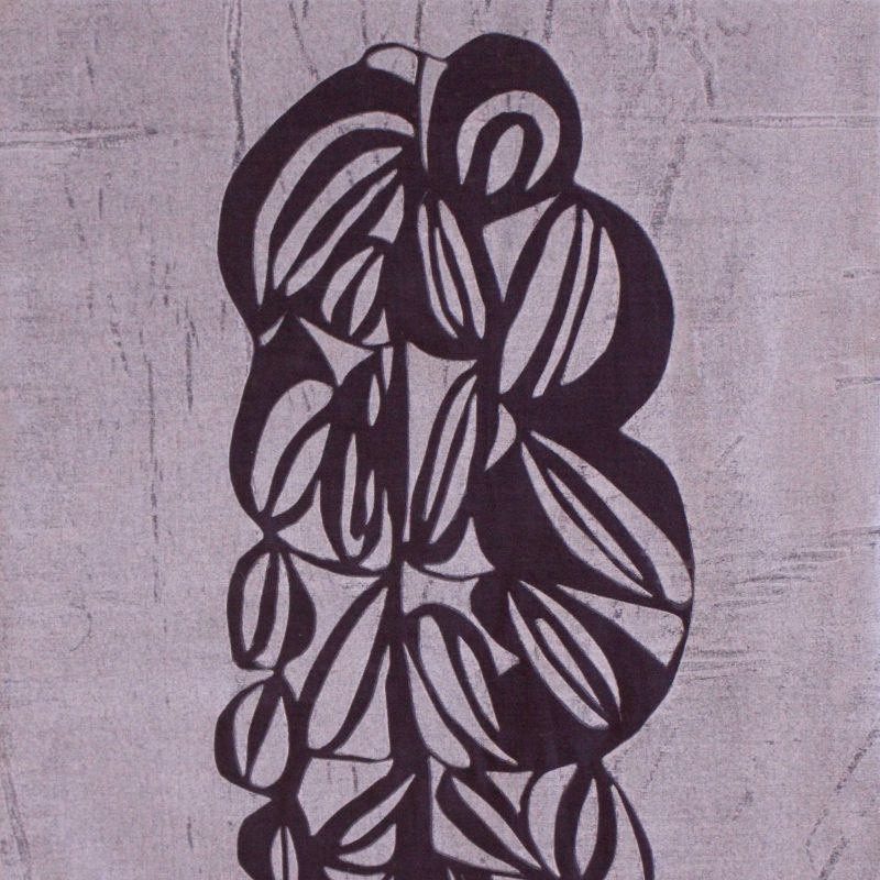 paper cut screen print on fabric with organic flowing leaf design in dark purple on pale background