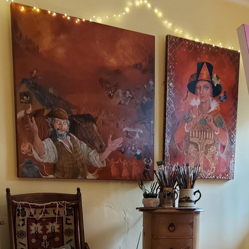 Two paintings hanging